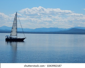 Shelburne, VT / USA - June 22, 2015: A sailboat scuds along Lake Champlain near Shelburne Farms in Vermont.