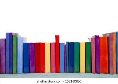 A shelf of colorful books and novels against a white background.