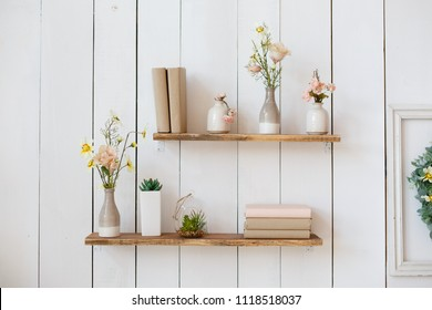 shelf with flowers and books