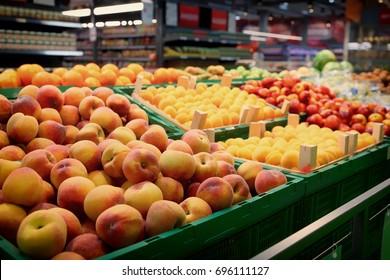 Shelf with fruits in large food supermarket, toned image