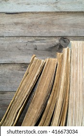 shelf with old books. wooden background