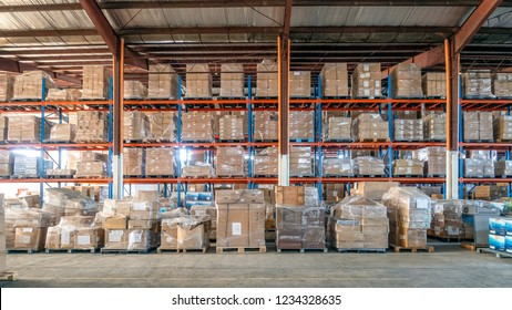 Shelf rack full of cartons at logistics warehouse