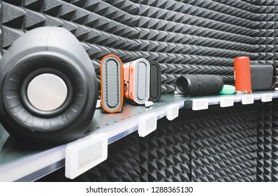 Shelf with speakers for listening to music in a technology store. Buy a music column. Background. Copyspace