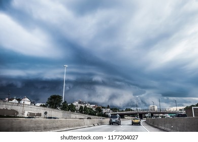 Shelf storm cloud over the highway in a city