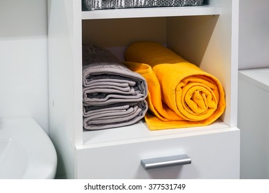 Shelf with towels in the bathroom