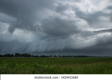 A shelfcloud of a severe thunderstorm over the wide open countryside of The Netherlands, western Europe. Severe weather is to be expected from this storm.