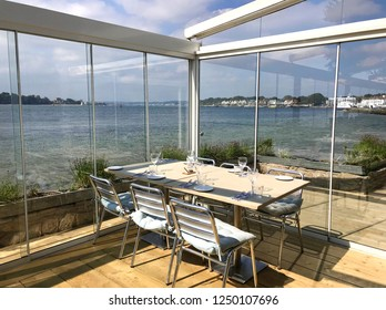Shell Bay, Poole, Sandbanks, Dorset, England.  May 8th 2018. Shell Bay seafood restaurant view from inside overlooking the  estuary to Poole Harbour and Sandbanks.