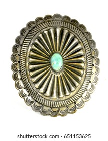 A shell belt buckle with a turquoise stone on silver from the southwest USA