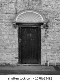 Shell Door Pediment in black and white tone, shallow depth of field vertical photography