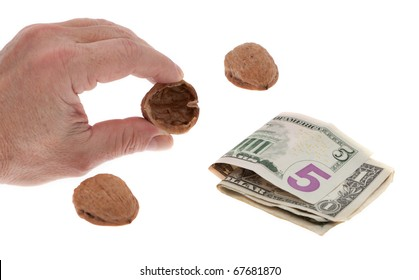 Shell game with money in front of white background