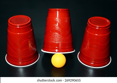 Shell Game with three red cups