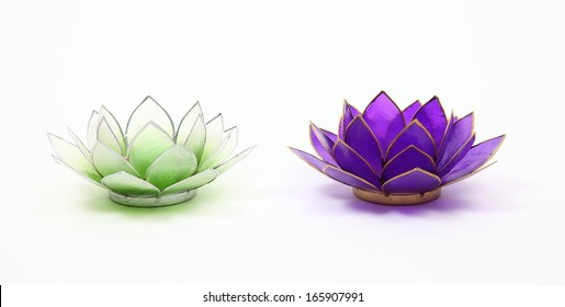 Shell lotus flower candle holders/Intimate moments 2/Two handcrafted traditional Phillipino candle holders made from shell and tin on white background