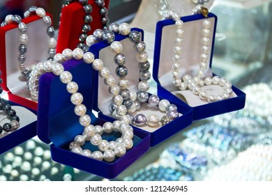 Shell pearl beads in the boxes