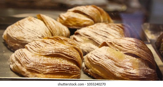 Shell shaped pastry 'Sfogliatelle' -  a traditional Neapolitan sweets Puff pastry, filled with sweet ricotta cheese. Served in a bakery displays in Rome, Italy