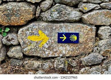 Shell sign and arrow of ancient pilgrim routes The Way of Saint James(El Camino de Santiago).