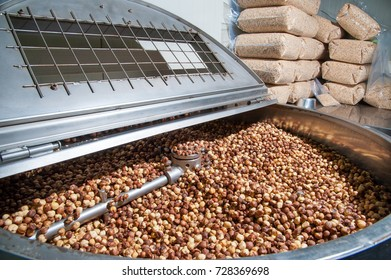 Shelled hazelnuts inside the machine for the peeling and blanching precess