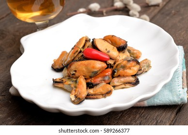 Shelled mussels on plate on the table