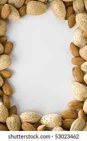 Shelled and un-shelled almonds creating a border