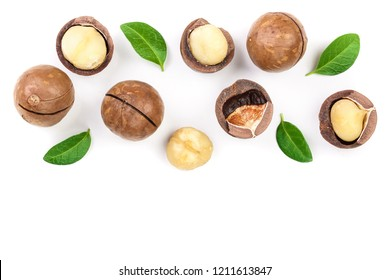 Shelled and unshelled macadamia nuts with leaves isolated on white background with copy space for your text. Top view. Flat lay pattern