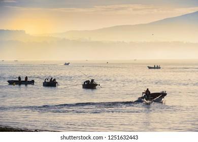 Shellfish fishermen at foggy, dawn in Arousa Island