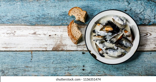 Shellfish Mussels Clams with blue cheese sauce on plate copy space