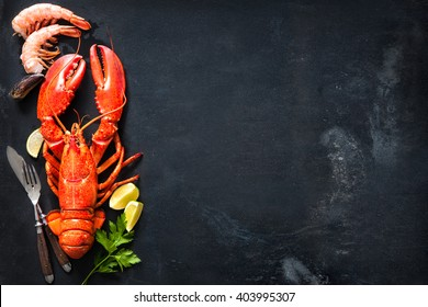 Shellfish plate of crustacean seafood with fresh lobster, mussels, shrimps as an ocean gourmet dinner background