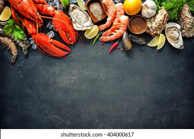 Shellfish plate of crustacean seafood with fresh lobster, mussels, oysters as an ocean gourmet dinner background