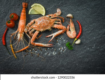 Shellfish seafood plate with shrimps prawns crab ocean gourmet dinner  seafood cooked with herbs and spices on dark background