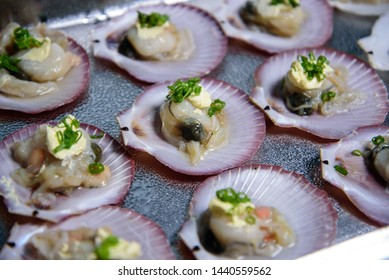 Shellfish, which is seafood on a white plate
