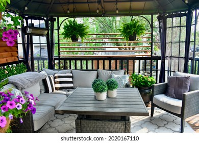 Sheltered outdoor summer lanai seating for relaxing warm days in backyard or on vacation