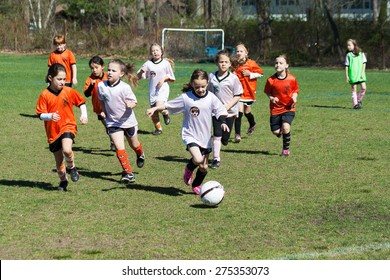 Shelton, CT, USA - May 2, 2015: An all girls team playing organized youth soccer game on May 2, 2015 in Shelton Connecticut.
