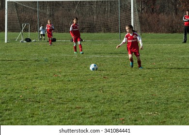Shelton, CT, USA - November 15, 2015: Daytime scene of young girls playing soccer in an all girls team on November 15, 2015, in a organized youth soccer game