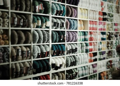 Shelves with assortment beauty colorful wool and yarn in knitting shop