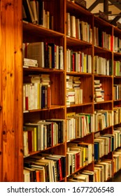 Shelves with books in a bookstore. Education and development. Blurred. Vertical.