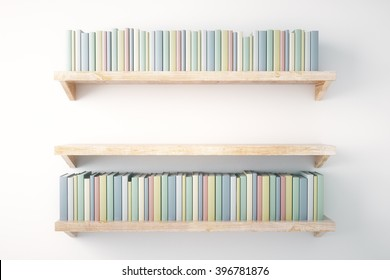 Shelves with books on painted white wall background
