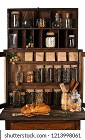 shelves with cans and products in an old wooden kitchen Cabinet