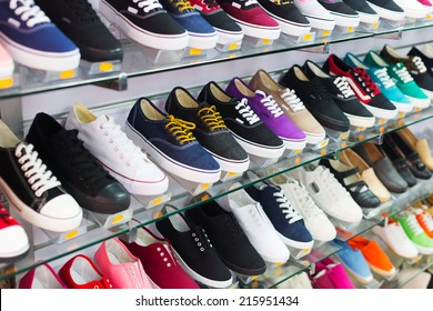 Shelves with casual shoes at fashionable shop