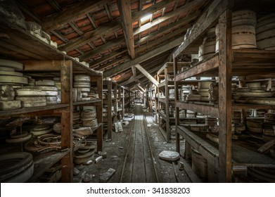 Shelves of clay moulds at an abandoned ceramics factory, HDR processing