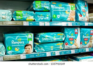 "Shelves with diapers under the brand ""Pampers"" of baby diapers for sale in supermarket."