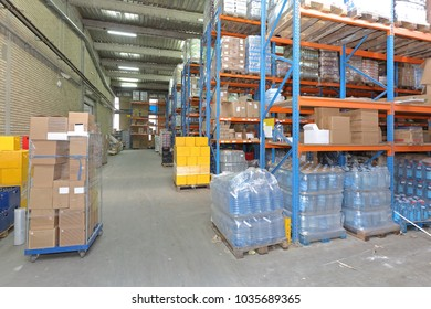 Shelves With Food and Drinks in Distribution Warehouse
