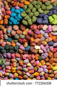 Shelves full of colored wool balls