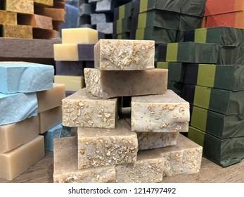 Shelves full of stacks of handmade soaps
