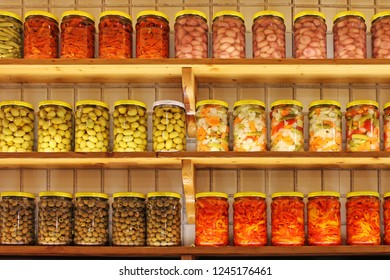 Shelves of Home Canning Vegetables. Food ingredients set in a row.