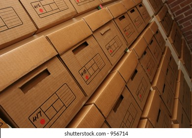 Shelves lined with boxes of company records in a secure records room environment.