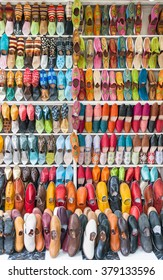 Shelves with lots of traditional colored slippers - Babouches. Slippers are soft and pleasant on the inside, the outside made of soft, embroidered with sequins and tiny beads of the camel skin.