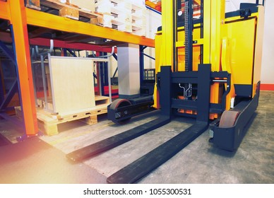 Shelves, racks and forklift  with pallets in distribution warehouse interior