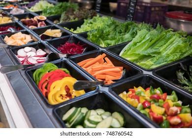 shelves of salad bar fresh vegetables