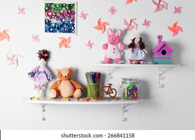 Shelves with toys in child room close-up - Shutterstock ID 266841158