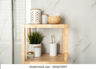 Shelving unit with toiletries in bathroom interior