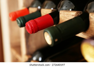 Shelving with wine bottles, closeup